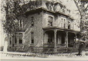 Holcombe House, built 1870, now City Hall, NE corner of Union and York - note the old porch!